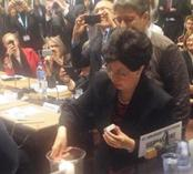 Dr. Chan lighting candle to honor health workers