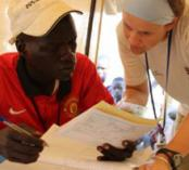 Nora Hellman training a South Sudanese nurse